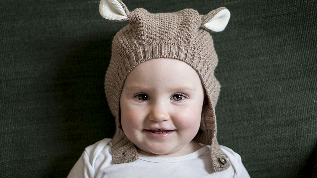 Ada wearing a knitted hat with bear ears